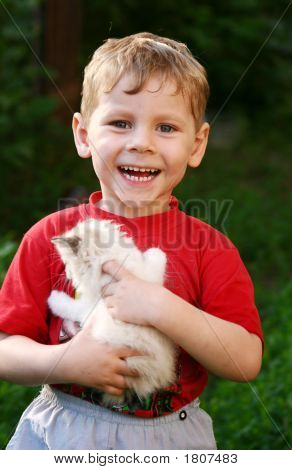 The Lovely Boy With A Kitten In Hands