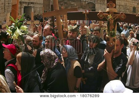 JERUSALEM - APRIL 21: Pilgrims come to Holy Sepulcher to pray, after a Crucession, in front of Temple, on Good Friday April 21, 2006 in Jerusalem, Israel.