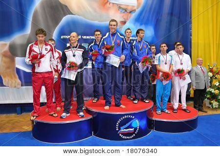 MOSCOW - OCTOBER 5: Winners in swimming championship 2010 in Olympic sporting complex on October 5, 2010 in Moscow, Russia.