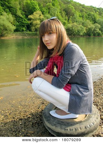 Teenage Girl With By The River