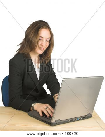 Business Woman Happily Using Her Laptop