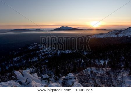 Sunset in Ural mountains.Taiga,Russia.Taganay park