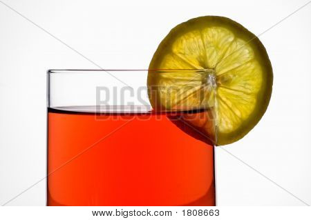 Glass Of Red Liquid (Wine,  Tea, Etc.) With Lemon Slice Closeup With Clipping Path