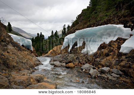 Mountain river Shumak,ice shapes on the coastline.