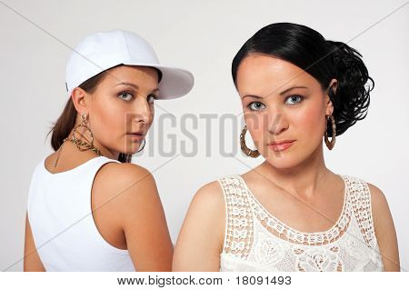 Portrait of beauty girl and pretty tomboy
