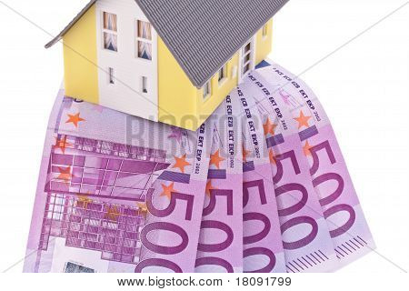 Many Euro notes and a house-