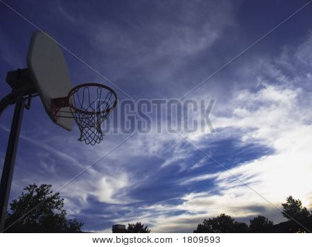 The Basketball Hoop Against The Blue Sky.
