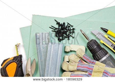 Plasterboard, tools, metal studs, screws,  and protective gloves on white background