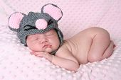 stock photo of newborn baby  - Newborn baby girl sleeping wearing a mouse hat - JPG