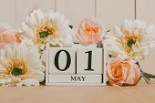 May 1St. Image Of May 1 White Block Calendar On White Background With Flowers. Spring Day, Empty Spa poster
