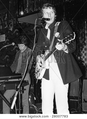 LONDON-AUGUST 20: Patrick Collier, lead singer of British pop group The Boyfriends, performs live on stage on August 20, 1978 in London. L-R, Chris Skornia, Patrick Collier