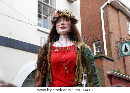 HASTINGS, ENGLAND - MAY 5: A large effigy of a woman (known as a Giant) is paraded during the May Day, Jack In The Green festival on May 5, 2009 in Hastings, East Sussex.