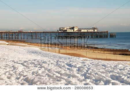 HASTINGS, ENGLAND - DECEMBER 3: Snow covers the beach on December 3, 2010 at Hastings, East Sussex. It is the coldest Winter in Britain for 100 years.