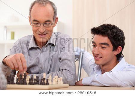 a senior man playing chess
