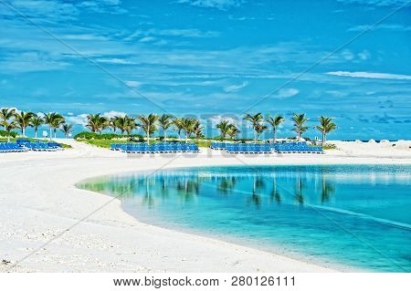 poster of Tropical Beach In Great Stirrup Cay, Bahamas. Sea Shore, White Sand, Palm Trees On Blue Sky. Summer