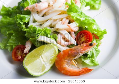 fresh salad leaves with lime and shrimp