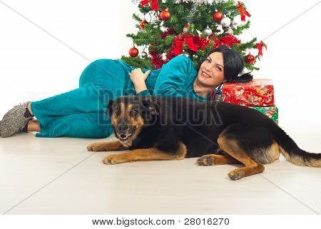 Woman In Pajama And Dog Near Xmas Tress