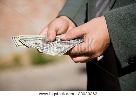 businessman hand with lot of money