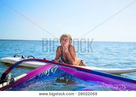 young beauty woman with windsurfing