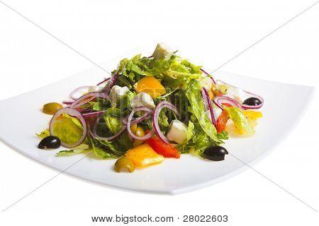 fresh Greek salad on white plate