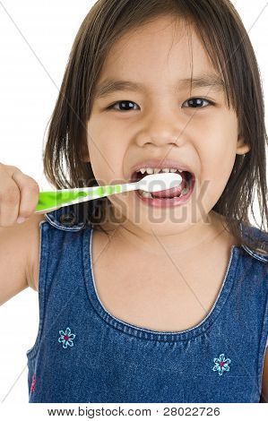 Little Asian Girl Brushing Her Teeth