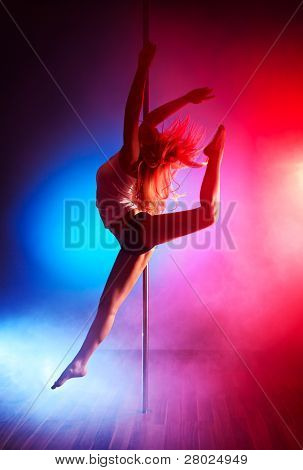 Young pole dance woman jumping.