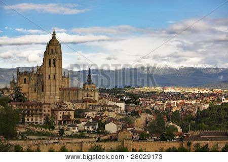 Cathedral in Segovia on a background of the cloudy sky and mountains