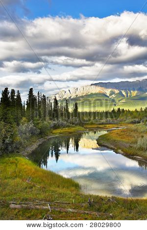River and mountains in the north of Canada in September. More magnificent pictures from the American and Canadian National parks you can look hundreds in my portfolio. Welcome!