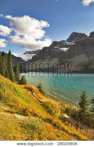 Northern lake surrounded by a wood and mountains in Canada. More magnificent pictures from the American and Canadian National parks you can look hundreds in my portfolio. Welcome!