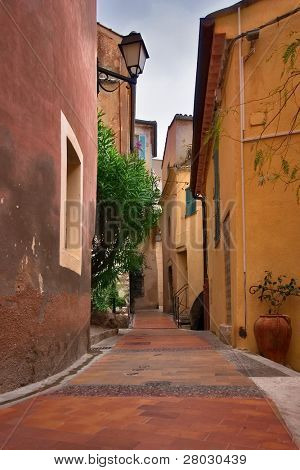 Narrow deserted street in medieval city