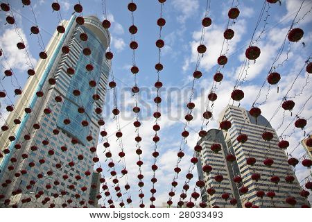 The traditional red lanterns decorating skyscrapers in China in New year