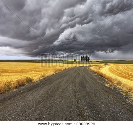 Thunder-storm above Montana. Fields after harvest and road
