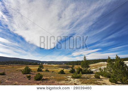 Flying clouds above meadows and woods of the most well-known park in the world Yellowstone national park