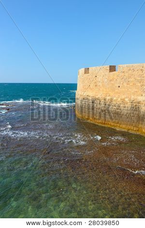 Superb kept protective fortification. Mediterranean sea, the ancient city of Akko, spring day