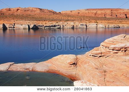 Antelope Canyon in the Navajo Reservation. Lonely boat with oars floating in the water channel