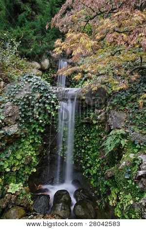 A small waterfall in the pond in the Japanese garden in Saratoga