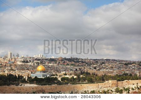 Dome of the Rock - a monument on the Temple Mount in Jerusalem. Gilded dome of the monument shining in the sun