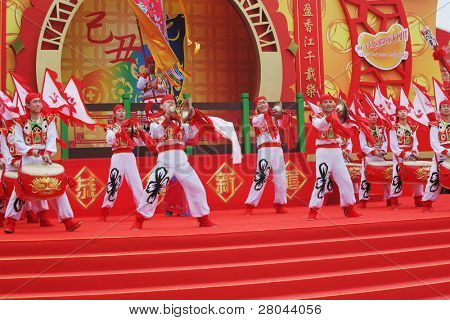 HONG KONG - JANUARY 24:  Scarlet flags and red and gold drums in the hands of the dancers. Park Ocean. January 24, 2009, Hong Kong, China. Concert in the Chinese New Year