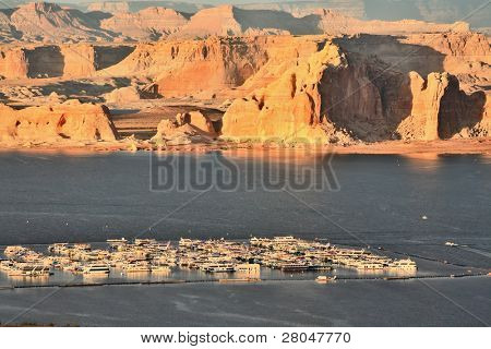 Fantastically beautiful landscape. Lake Powell sunset. Boats in the lake port