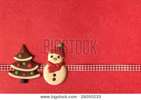 Christmas cookies with beautiful ribbon on red background