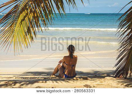 poster of Traveler Girl Relaxing On Tropical Beach. Young Girl Traveler Relaxing In Vacation. Traveler Relaxin