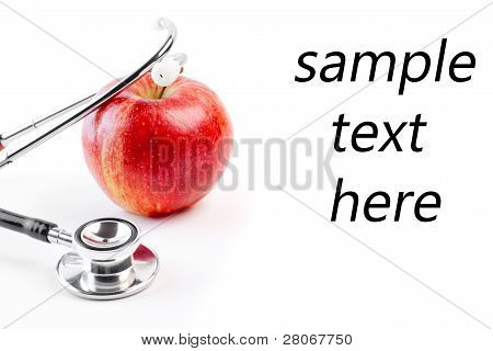 Medical Stethoscope On Red Apple