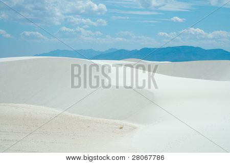sand dune hills and blue mountains