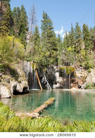 Hanging Lake, clear green water lake in the forest and waterfall