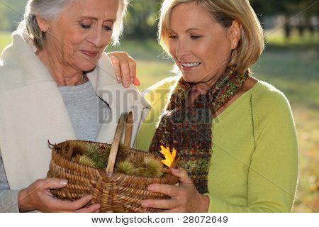 senior dames back from ramble through nature