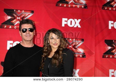 "LOS ANGELES - DEC 19:  Simon Cowell, Melanie Amaro at the FOX's ""The X Factor"" Press Conference  at CBS Studios on December 19, 2011 in Los Angeles, CA"