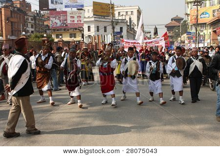 KATHMANDU - DECEMBER 30: Nepalese caste Gurung celebrate their traditional New Year December 30, 2008 in Kathmandu, Nepal. The procession in traditional costumes goes around the city.