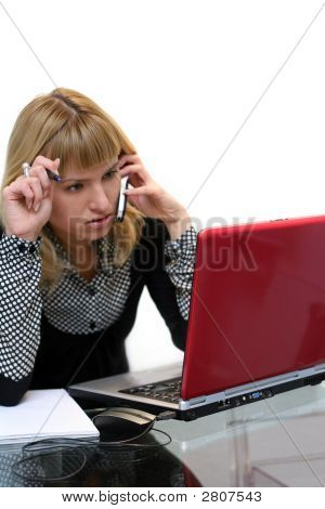 Woman Is Thinking And Calling By Phone Sitting Near Laptop