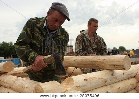 TOMSK, RUSSIA - AUGUST 9: Participants take part in Annual international festival-competition of carpenters