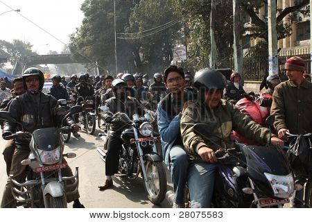 KATHMANDU, NEPAL - DECEMBER 30: Nepalese caste Gurung celebrate their traditional New Year, the police blocked the road, formed motorcycle traffic jams, December 30, 2008 in Kathmandu, Nepal.